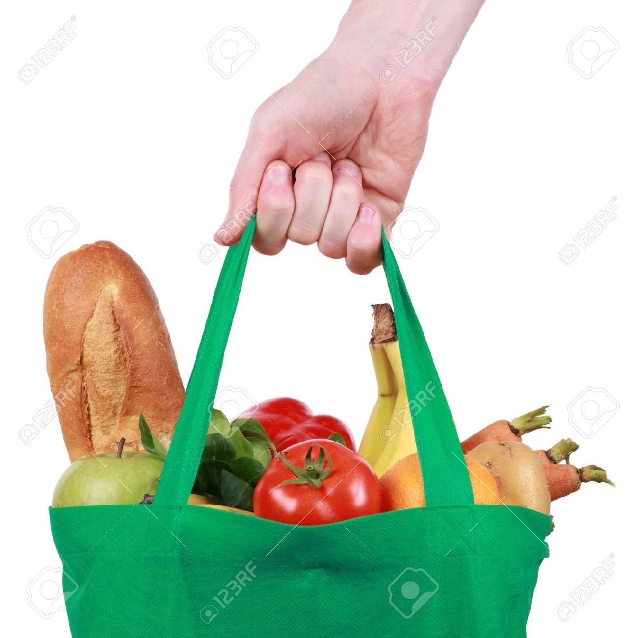 Hand Holding A Reusable Shopping Bag Filled With Fruits And ...
