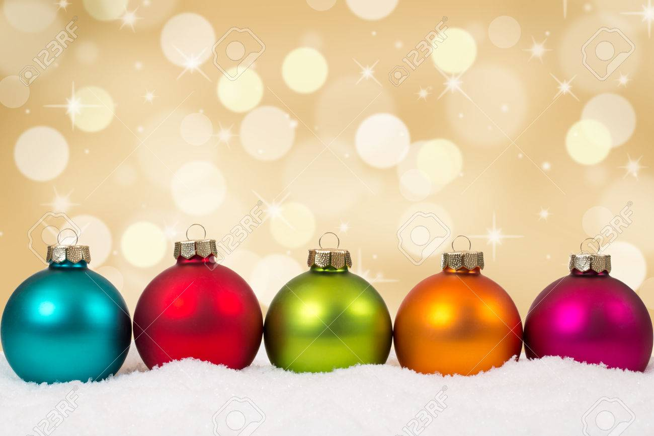 Colorful Christmas.Colorful Christmas Balls In A Row Golden Background Decoration