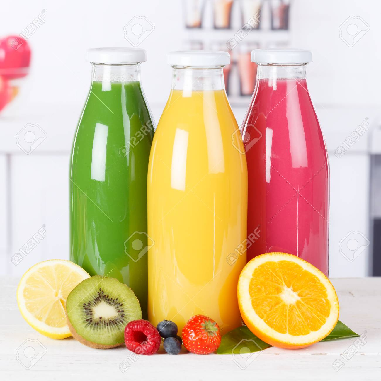 Juice smoothie orange smoothies in kitchen bottle square fruit fruits fresh drink stock photo 100986471