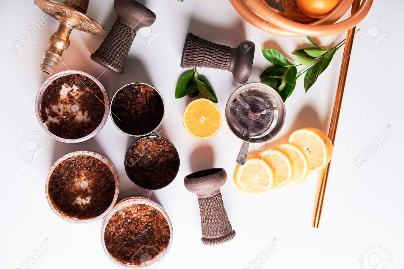 Top view of shisha details with orange and hookah tobacco flavors