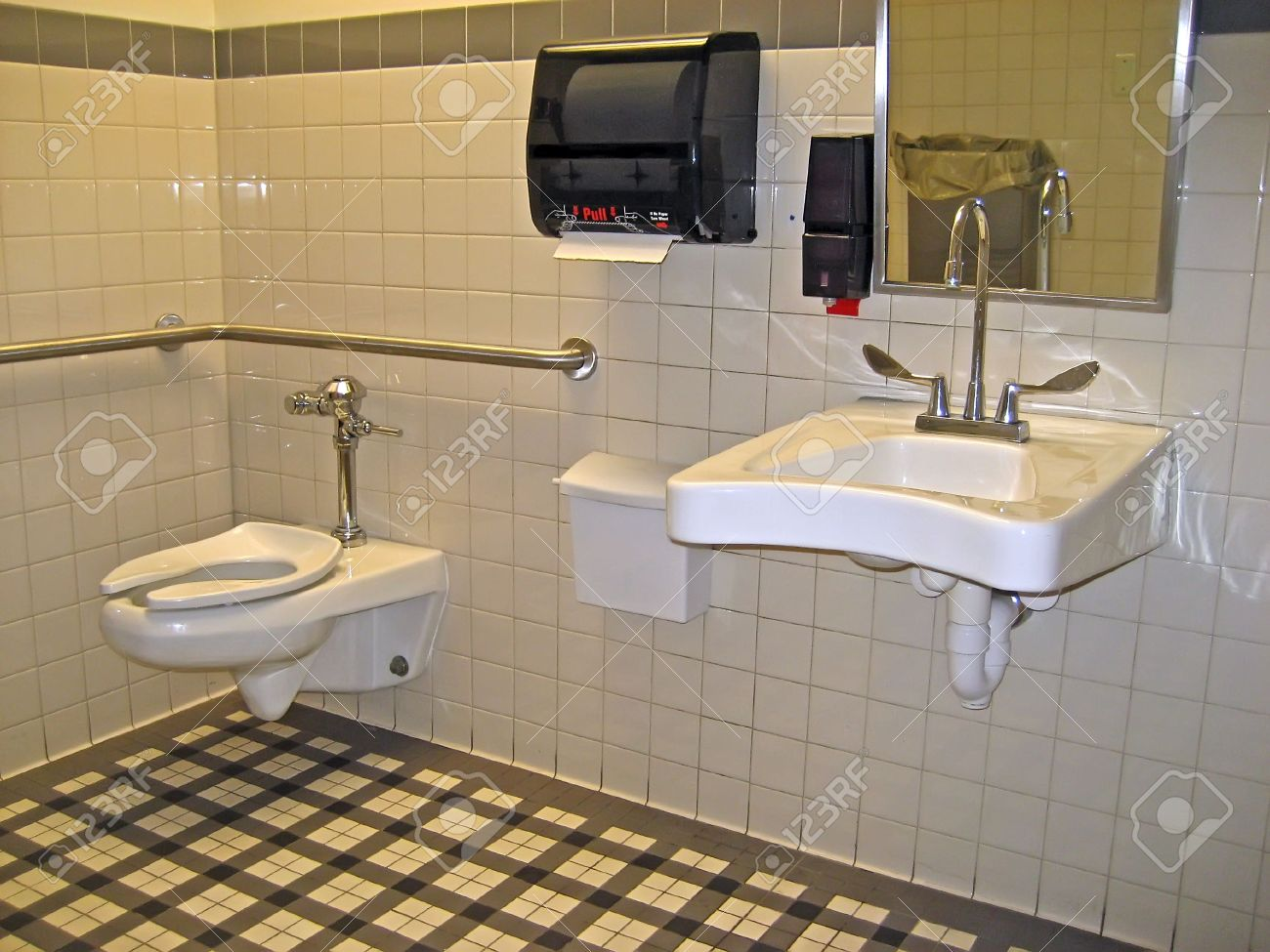 Clean Public Bathroom With Off White Tiles Stock Photo