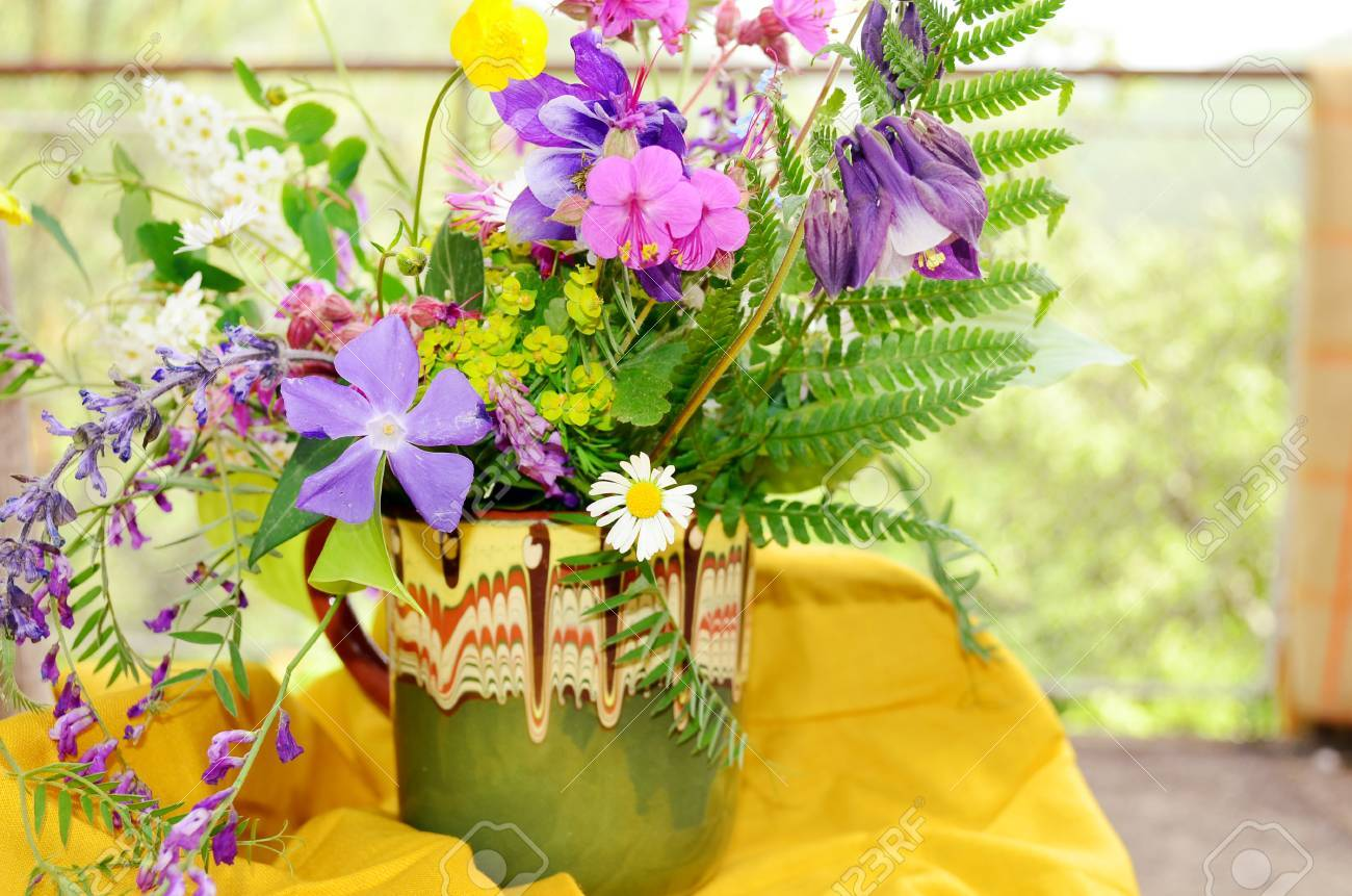 Hand made vase with colorful spring wild flowers stock photo hand made vase with colorful spring wild flowers stock photo 50733996 mightylinksfo Image collections