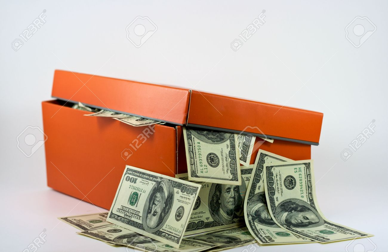 Shoebox Full Of Money.A Shoe Box Full Of Money Is Overflowing With Cash This Is No