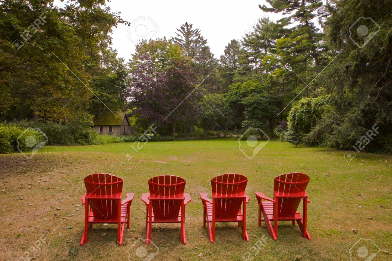 Four Red Adirondack Chairs In A Green Meadow Done In Landscape V Stock  Photo   5354756