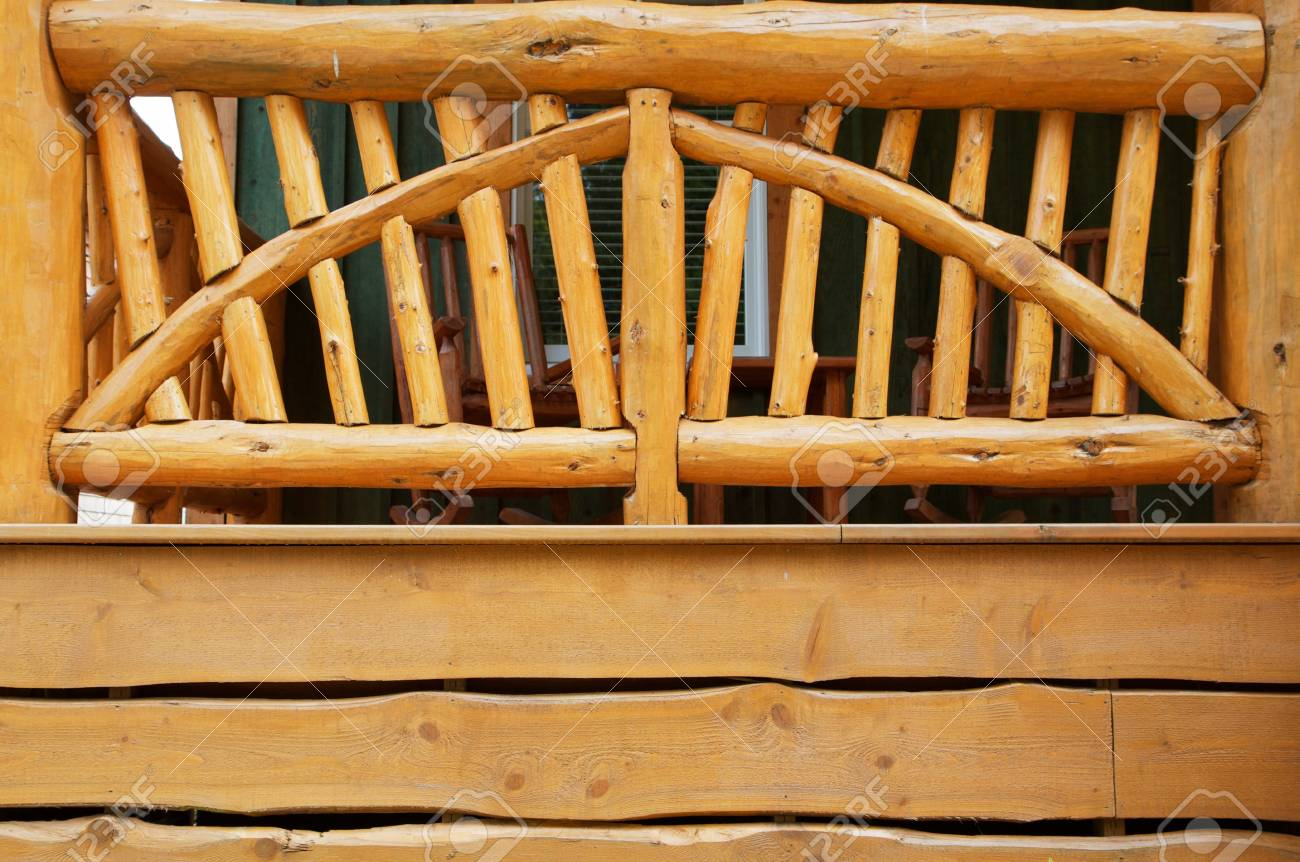 Pioneer mountain style porch made of logs and branches and simple cut wood Stock Photo - 7565678