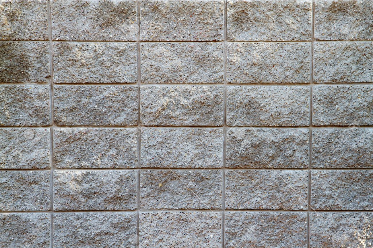 Several Rows Of A Rough Textured Concrete Block Wall Stock Photo - Cinder block wall