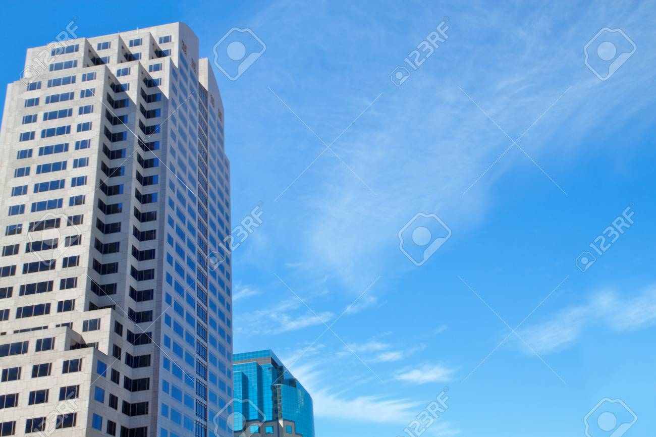 Two office buildings with blue sky cloudscape Stock Photo - 7858545