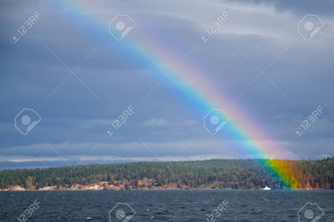 Bright Rainbow Arching Over Discovery Bay In Washington Stock Photo Picture And Royalty Free Image Image 8223662