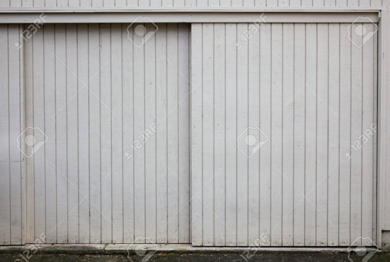 Old style Sliding beige painted wood garage doors Stock Photo - 8531880