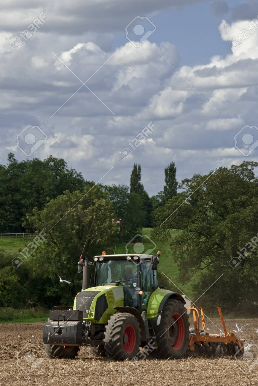 Tractor pulling a plough followed by hungry seagulls Stock Photo - 10650257