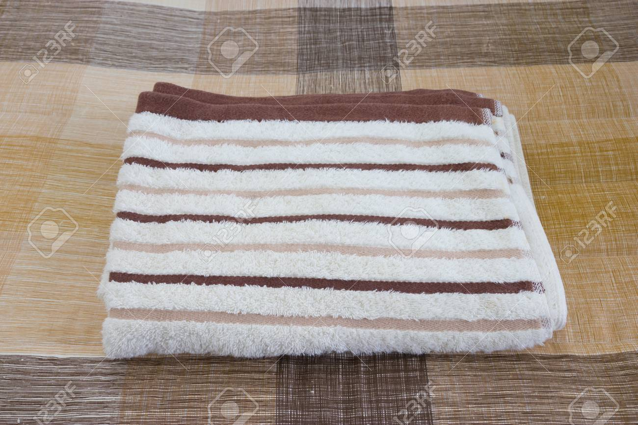 Towel on the bed Stock Photo - 23031767
