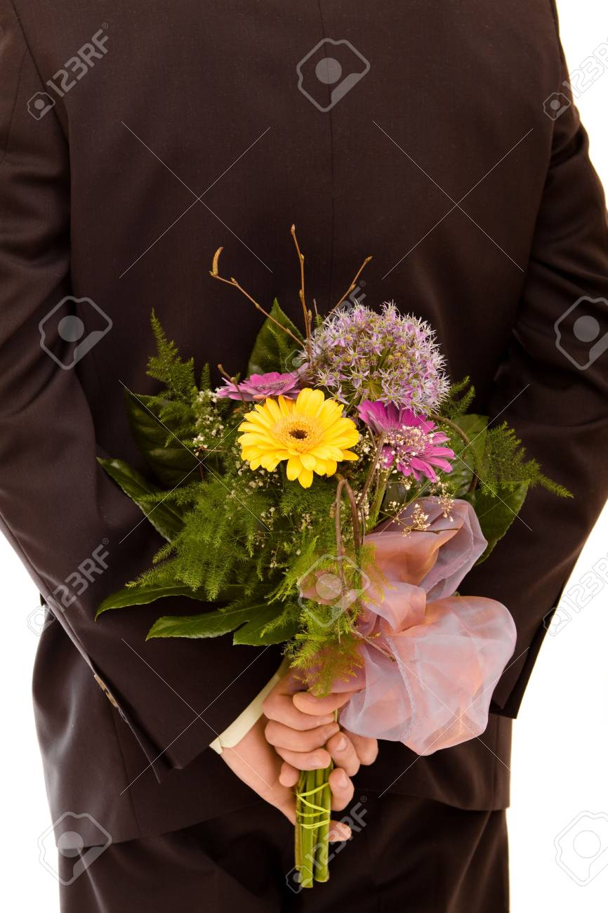Man with flowers on white background Stock Photo - 4673685