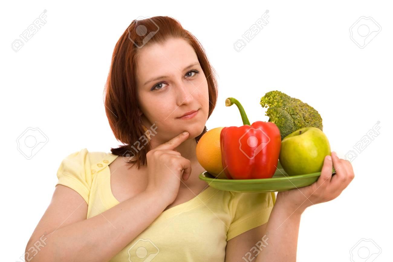 Mujer comiendo vegetales sobre fondo blanco Foto de archivo - 4815587