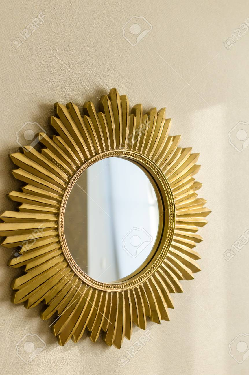 Beautiful Modern Golden Mirror In Shape Of Sun On The Wall At ...