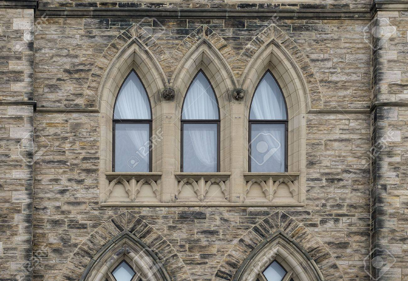 Building Exterior With Gothic Architecture Window Stone Pattern Stock Photo