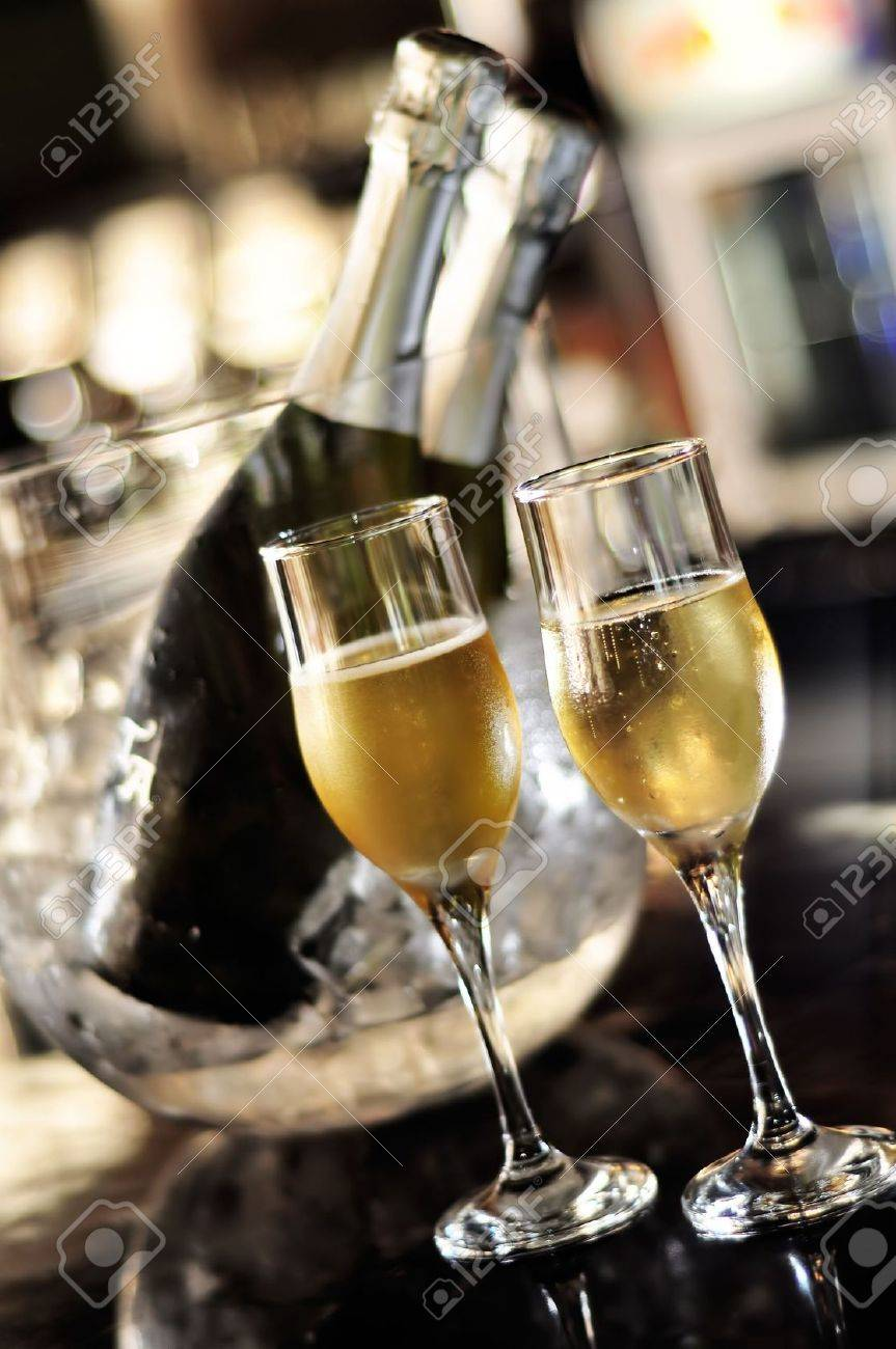 Isolated glasses of champagne with bottle background Stock Photo - 7606173