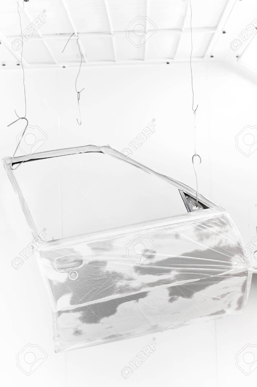 Automobile door hanging for painting in a car spray body shop Stock Photo - 17167619