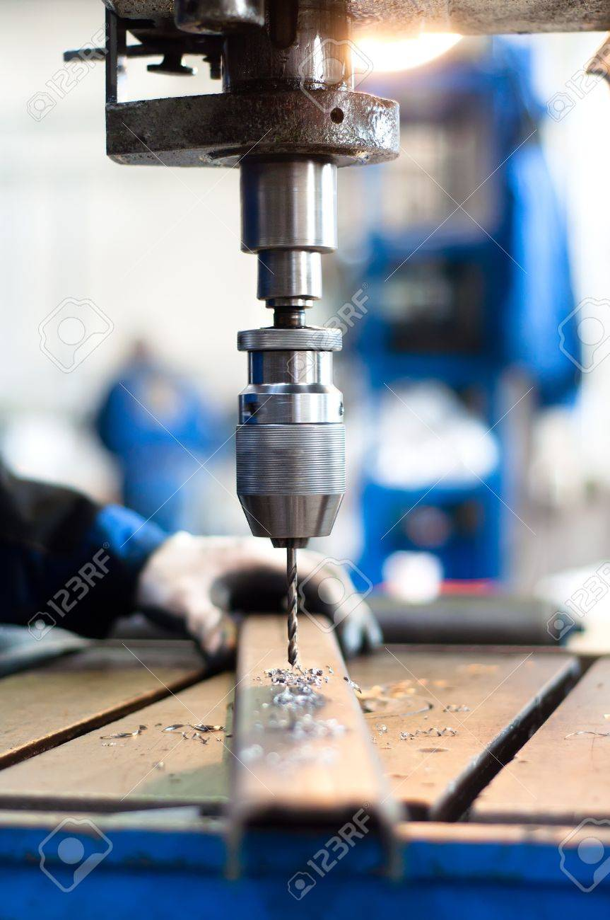 industrial worker using a mechanical drill machine Stock Photo - 17502044