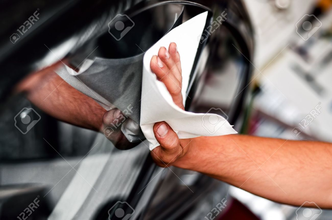 auto car worker and mechanic cleaning a cars window with special tool for scratches and wiper Stock Photo - 21727710