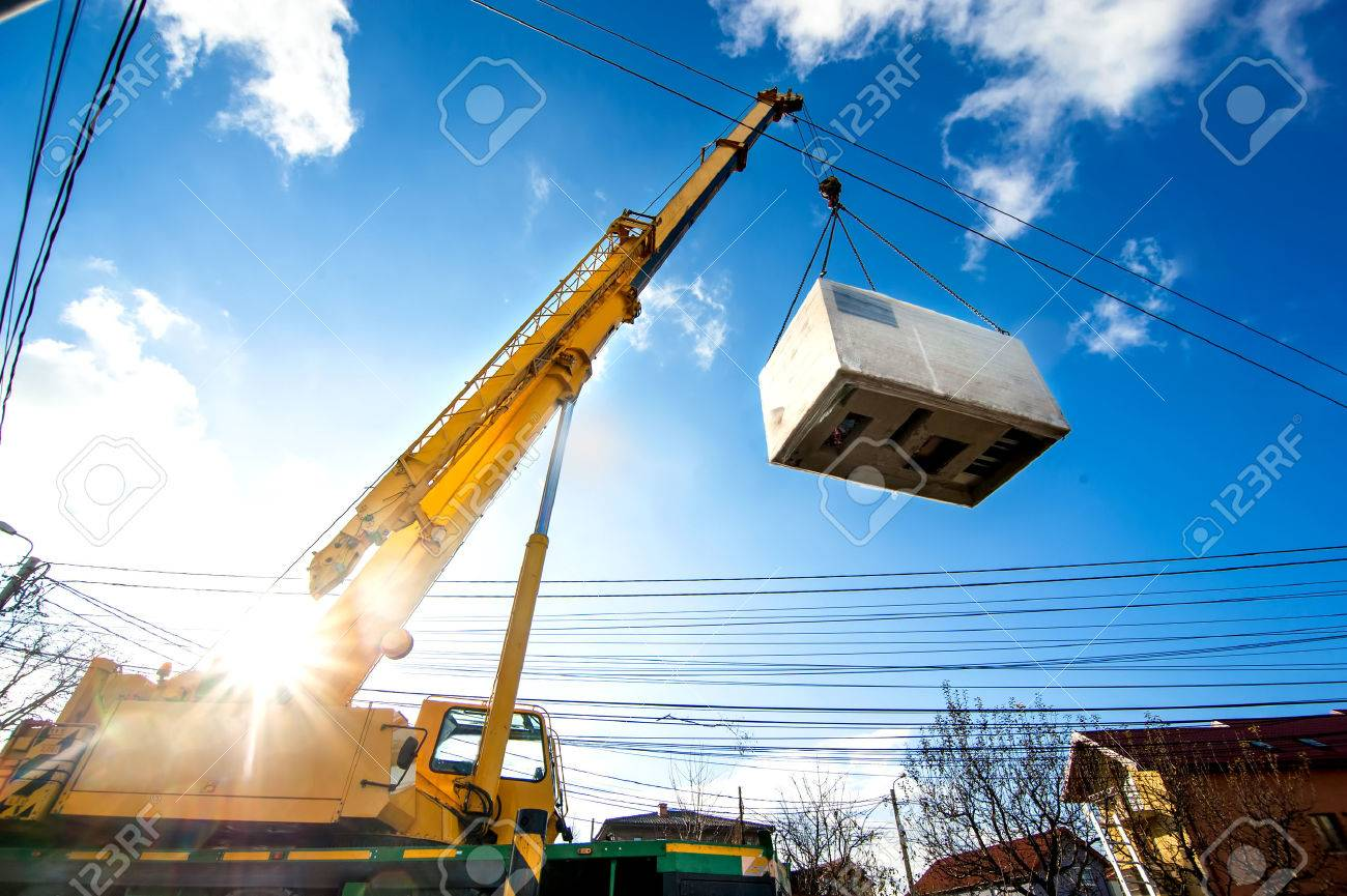 Mobile crane operating by lifting and moving an heavy electric generator - 24477593