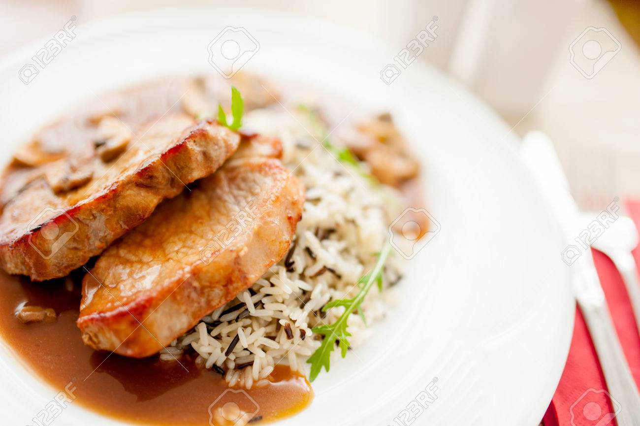 Grilled Pork Chop And Rice As Main Course Fancy Restaurant Meals Stock Photo Picture And Royalty Free Image Image 27311360
