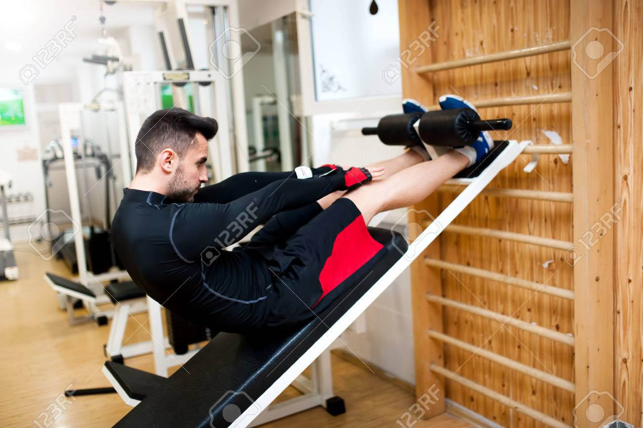 Handsome Muscular Man Doing Sit Ups On A Incline Bench At Fitness Stock Photo Picture And Royalty Free Image Image 27446178