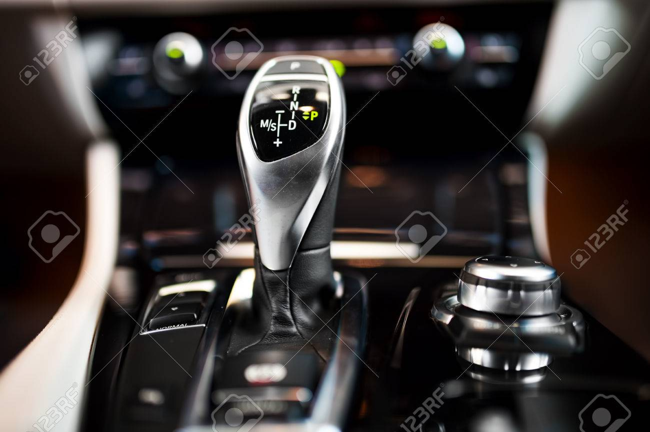 Detail of an automatic gear shifter in a new, modern car Modern