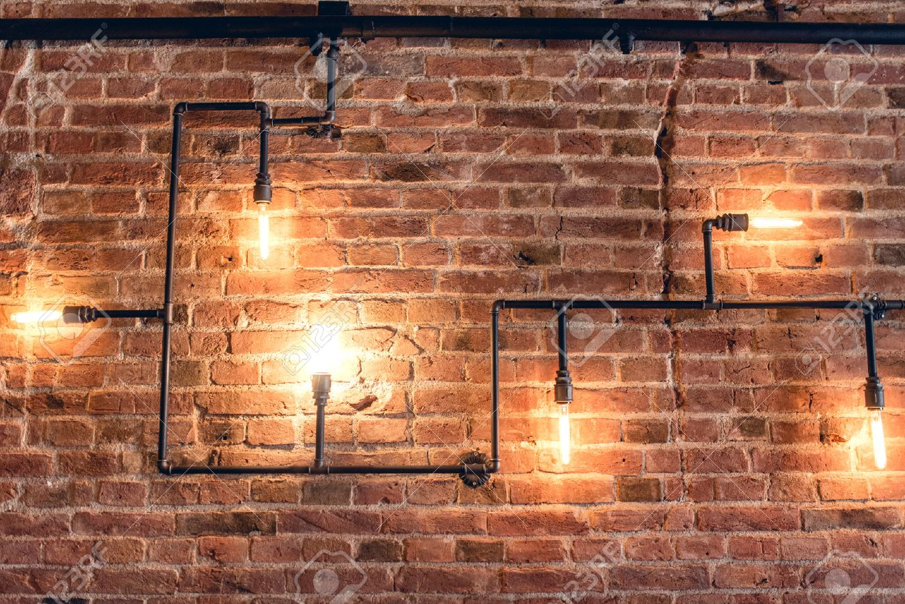 Interior Design Of Vintage Wall. Rustic Design, Brick Wall With Light Bulbs  And Pipes