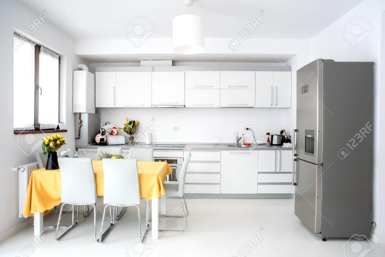 Open Space Cucina E Soggiorno interior design, modern and minimalist kitchen with appliances..