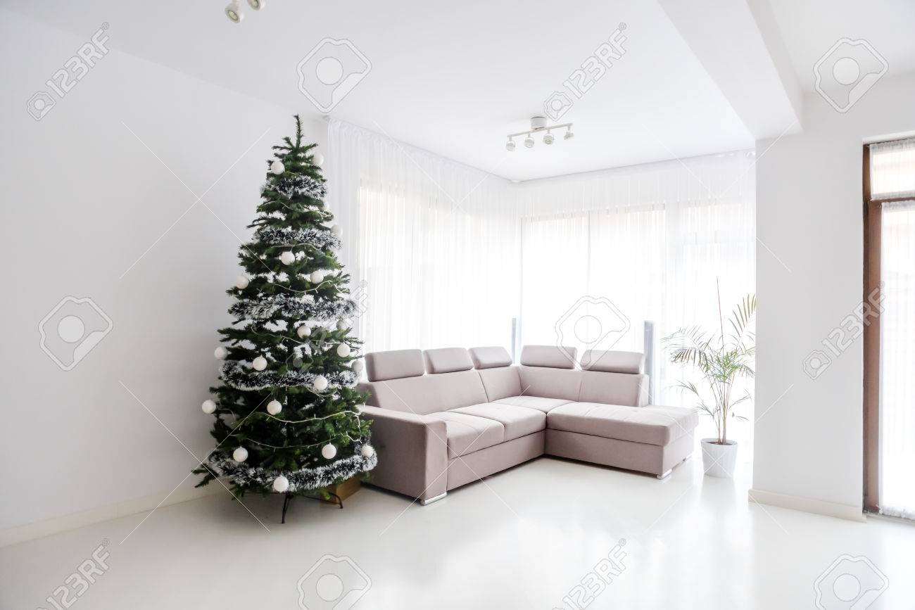 Modern Living Room Space, Comfortable Sofa And Christmas Tree ...