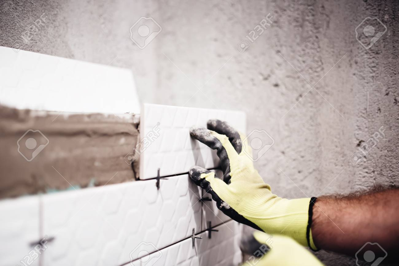 Industrial Worker Placing Small Ceramic Tiles With Plastic Spacer ...