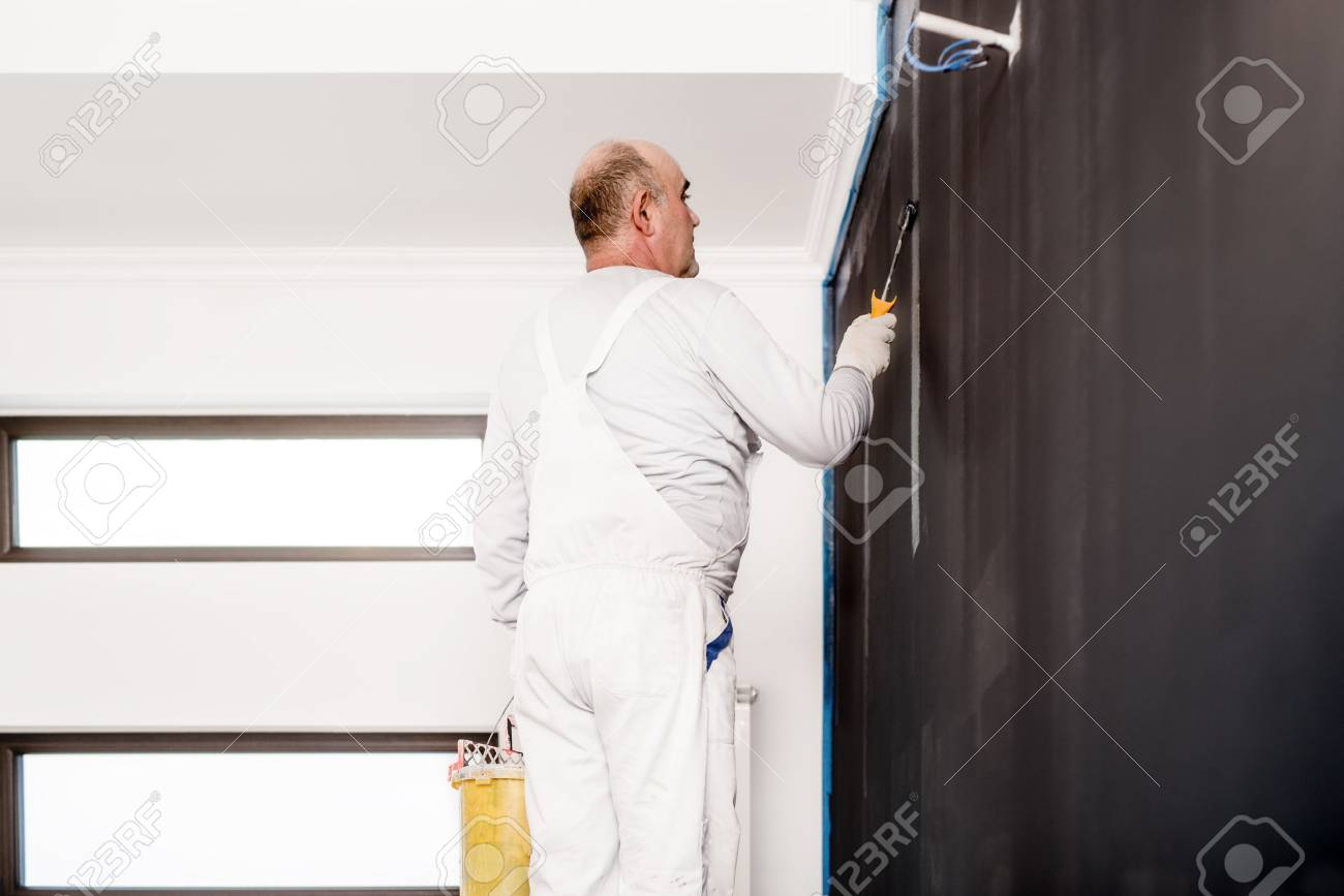 Decorating a wall with pictures gallery home wall decoration ideas bald man worker using tools for decorating a wall with grey bald man worker using tools amipublicfo Choice Image