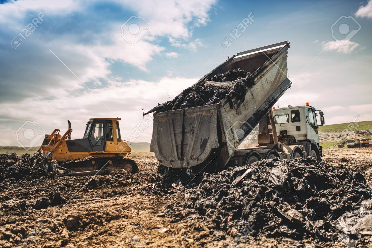Dumping Truck Unloading Garbage At Site Industrial Bulldozer Excavator And Trucks Working