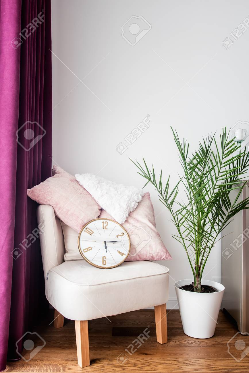 Purple Drapes, Cozy Armchair, Pillows And Tv Stand In Modern Living Room  Stock Photo