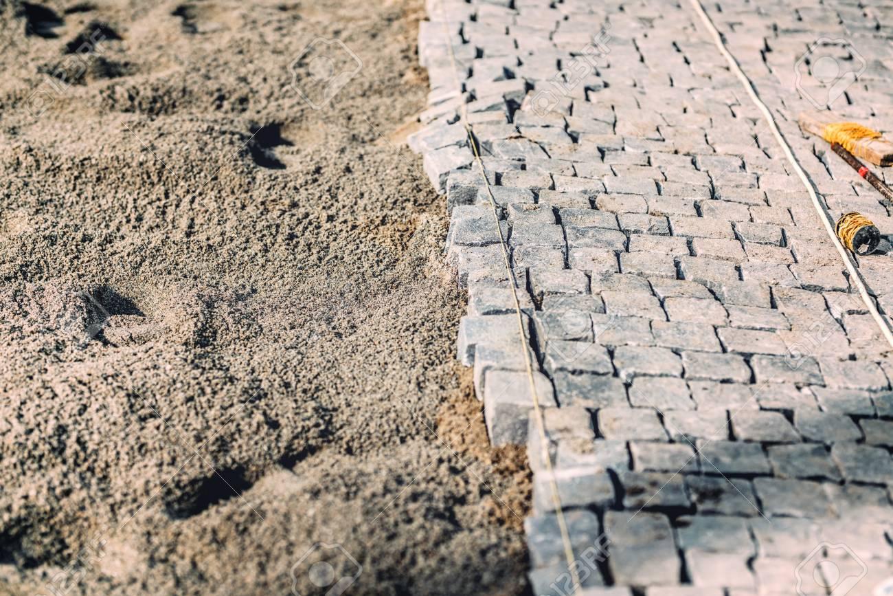 Cobblestone avenue install details  Road pavement with granite