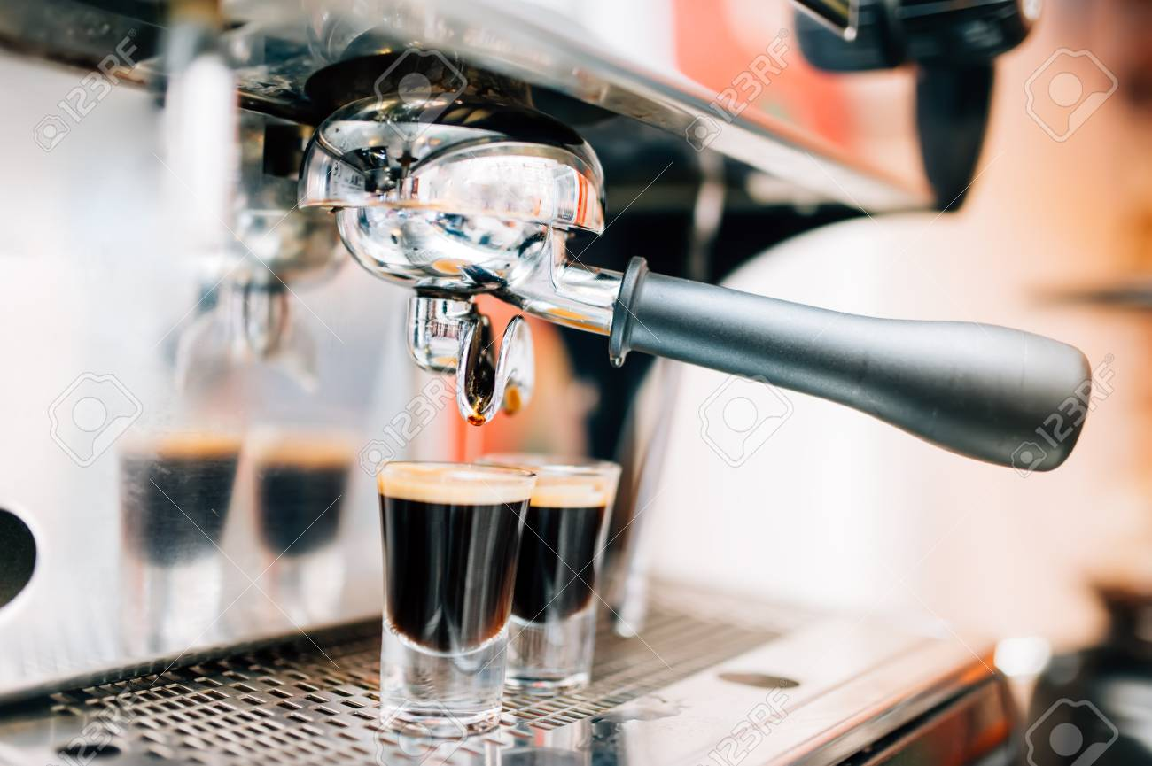 Close Up Of Espresso Machine Pouring Fresh Coffee Into Cups At