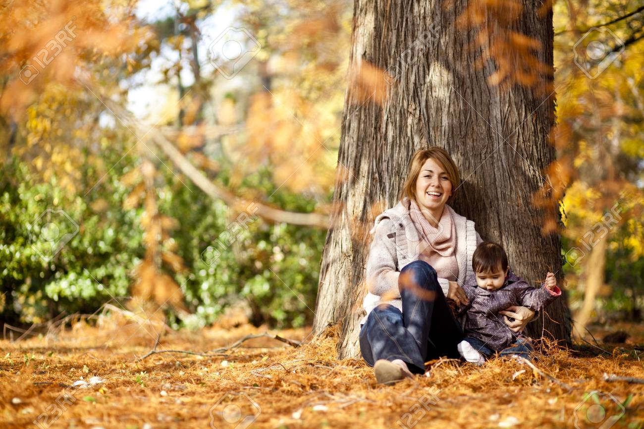 Mother and baby girl in the autumn forest Stock Photo - 15959128