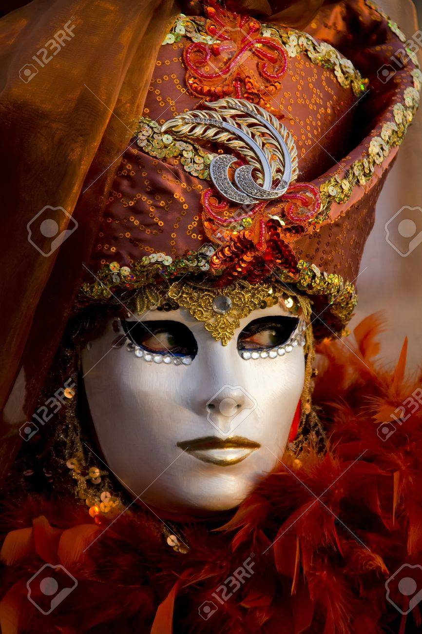 Venice, Italy, February 9, 2013: Unidentified person with traditional Venetian carnival mask in Venice, Italy at February 10, 2013. At 2013 it is held from January 26th to February 12th. Stock Photo - 19814887
