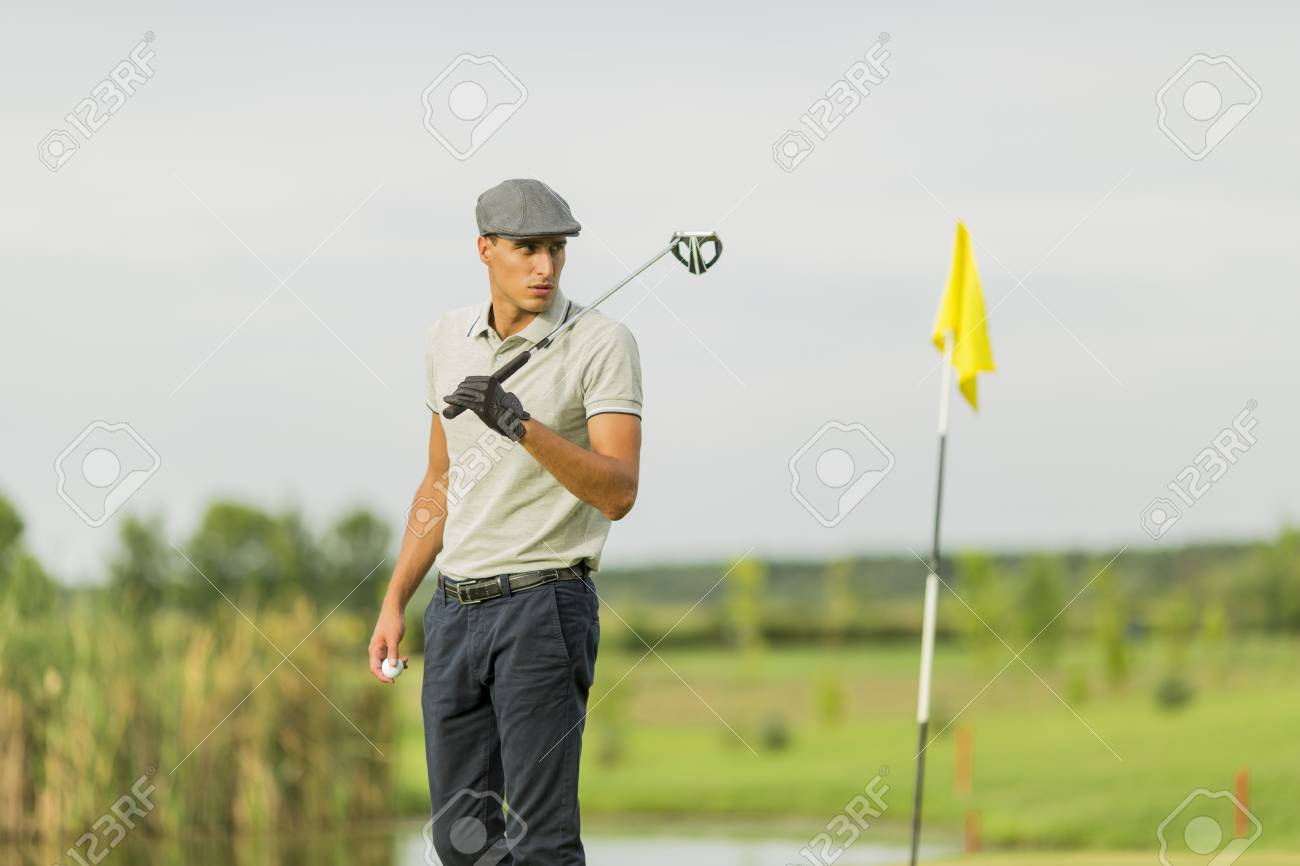 Young man playing golf - 32547554