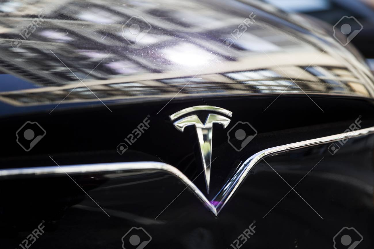 NEW YORK, USA - AUGUST 30, 2017: Detail from Tesla car in New York. It is an American company that specializes in electric automotives founded at 2003. - 95945131