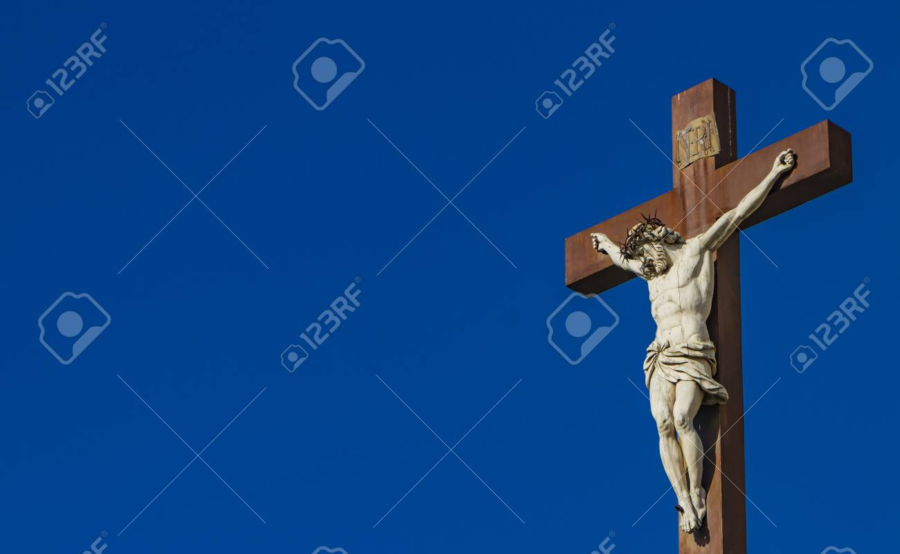 Jesus Christ on the Cross in front of Avignon Cathedral in France - 121994365