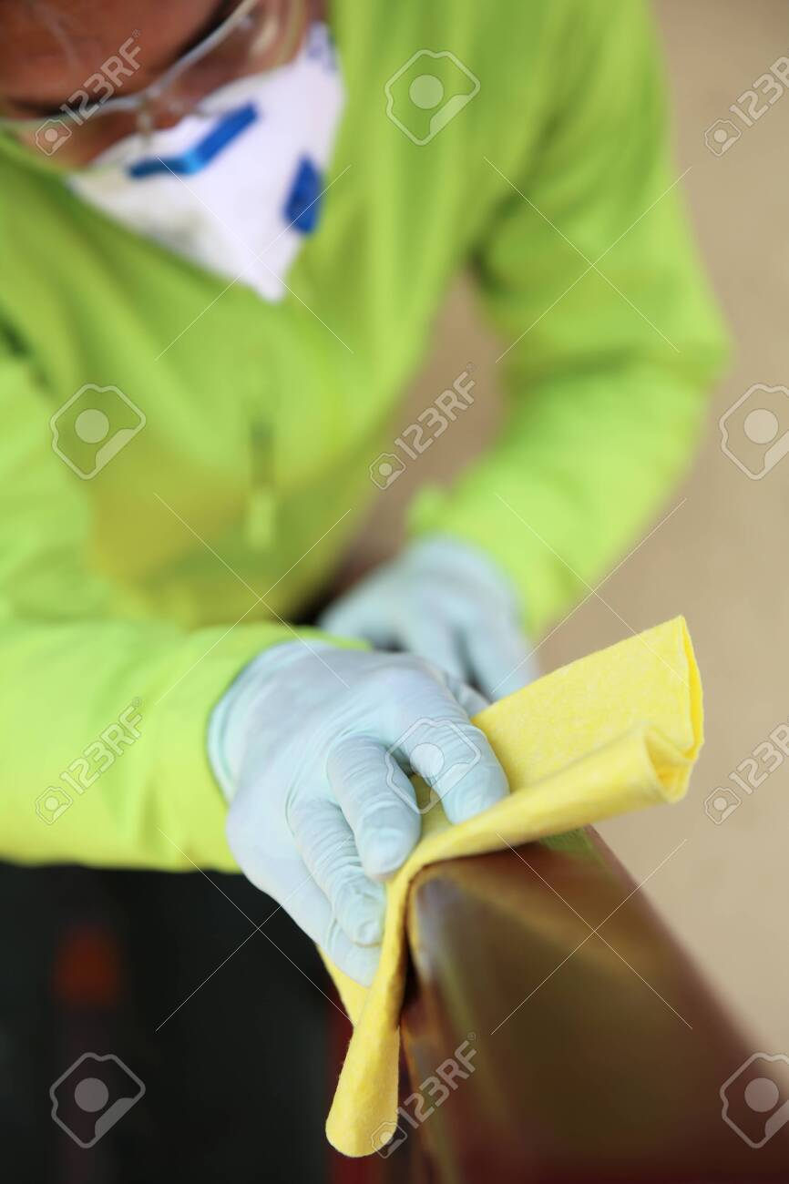 Closeup of deep cleaning of surface with alcohol for virus desease prevention - 143194112