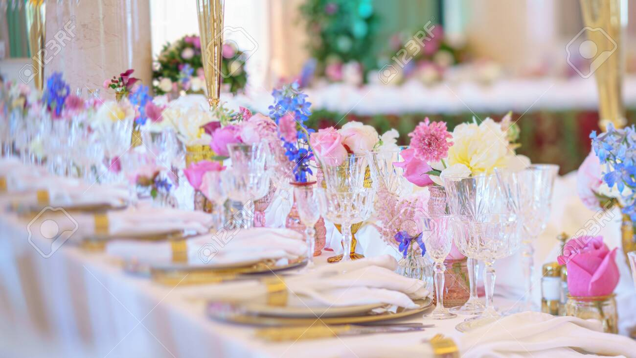 Catering table set service with silverware, napkin and glass at restaurant before party - 130904059
