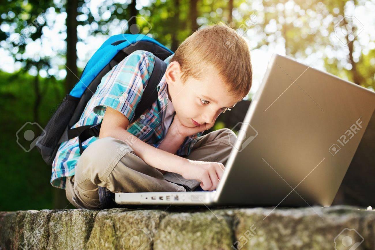 Boy focused on notebook - 15202343