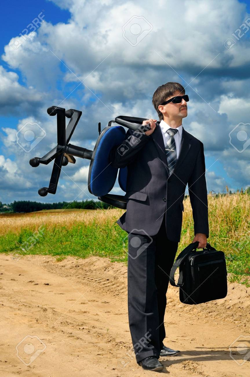 Young successful businessman takes his work to field Stock Photo - 4302869