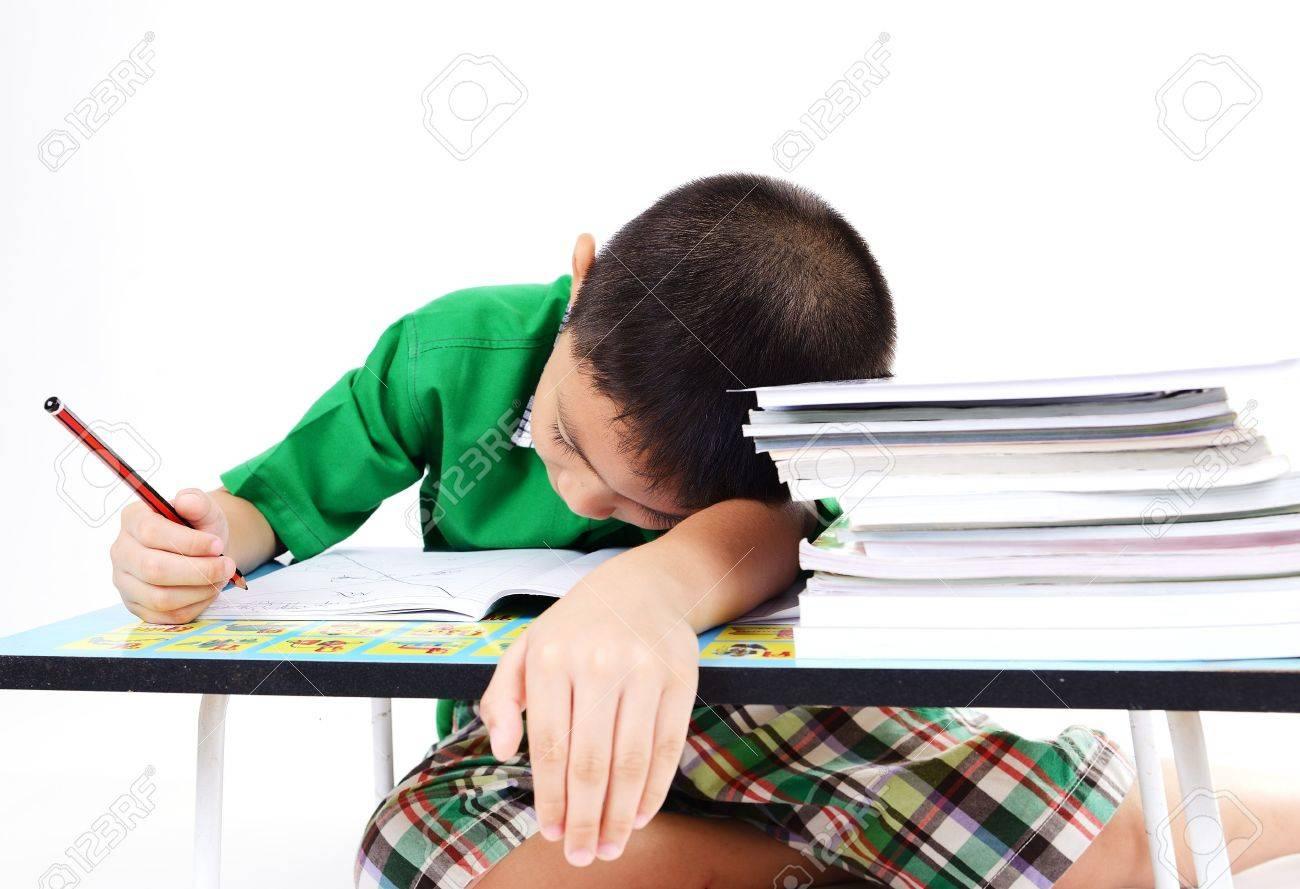 Student boy sleep while doing homework - 22170319