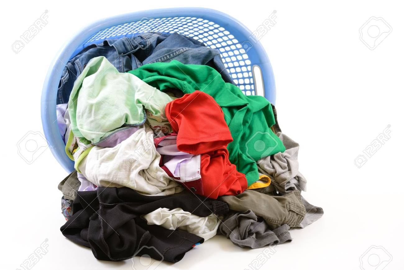 Clothes in a laundry basket isolated on white background - 22187326