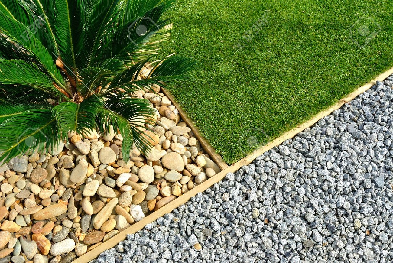 Landscaping Combinations Of Grass, Plant And Stones Stock Photo ...