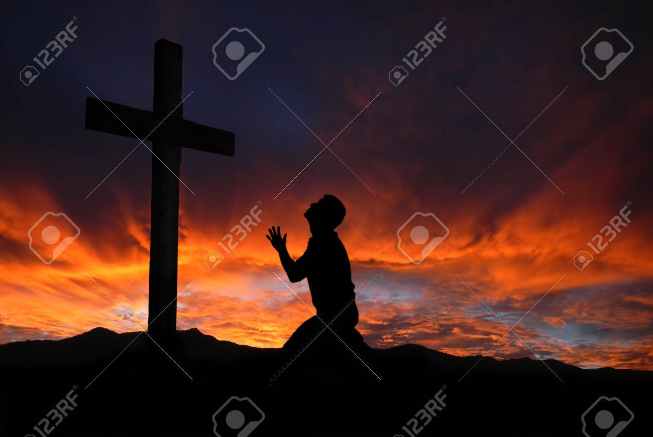 Dramatic sky scenery with a mountain cross and a worshiper - 35951200