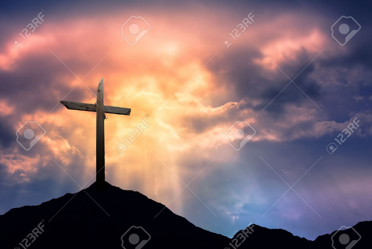 Silhouette of the holy cross on background of storm clouds stock - Wooden Cross Silhouette Of Cross At Sunrise Or Sunset With Light Rays